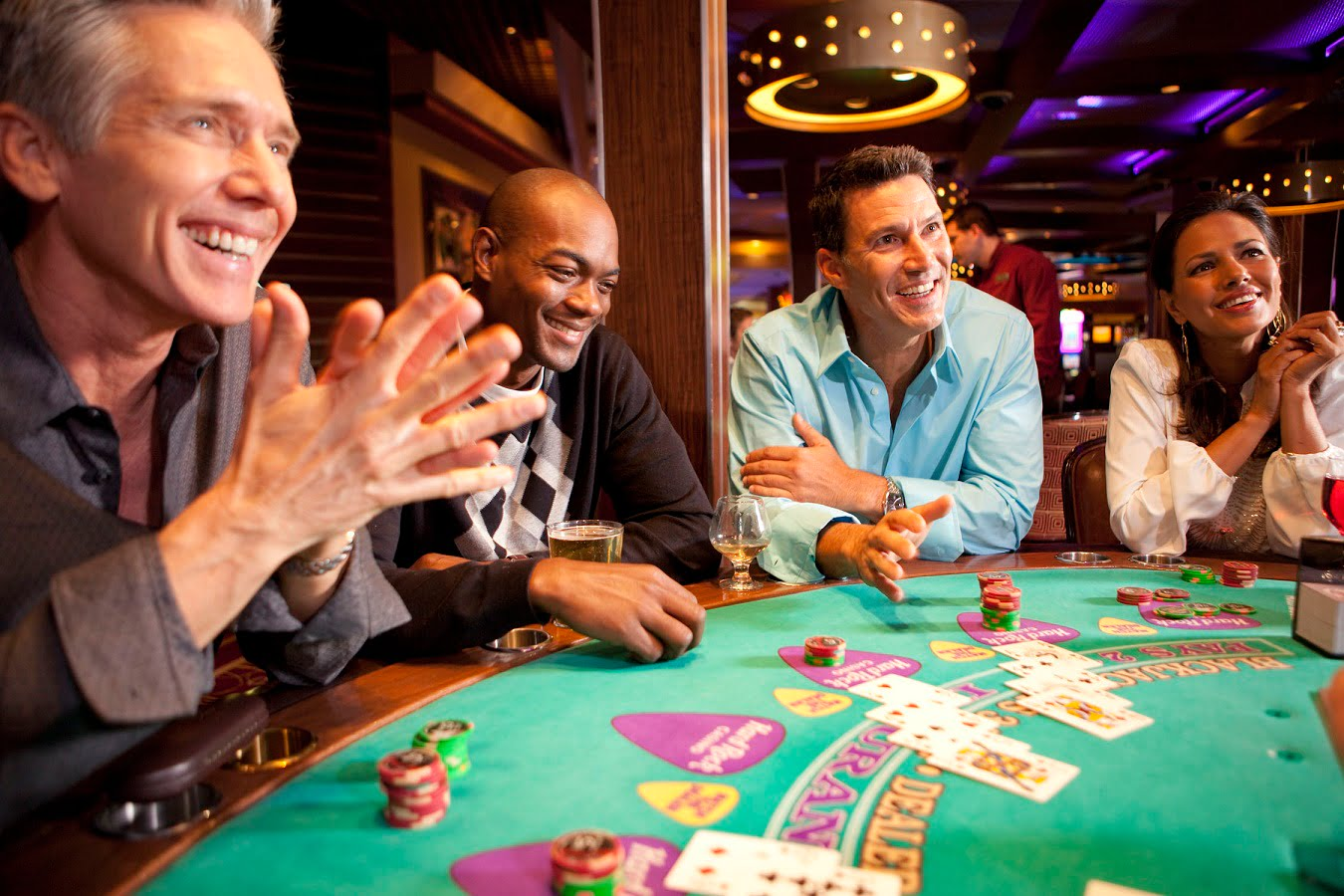 a group of people playing blackjack