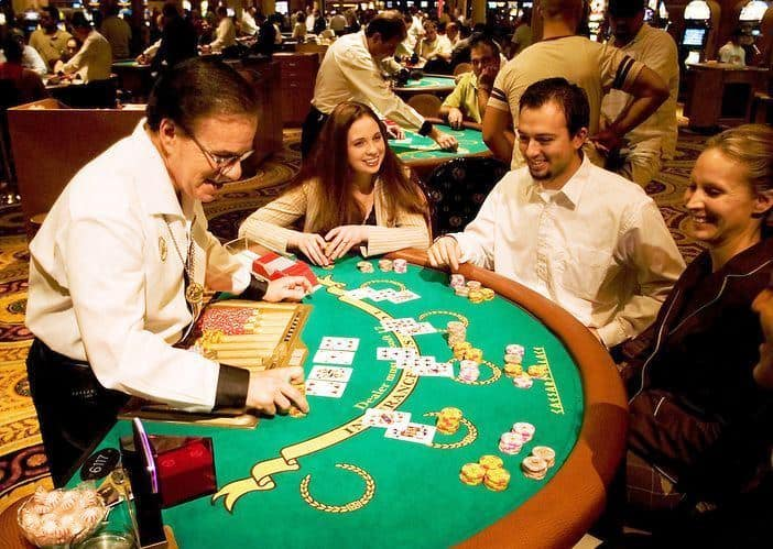 casino dealer entertaining the guests