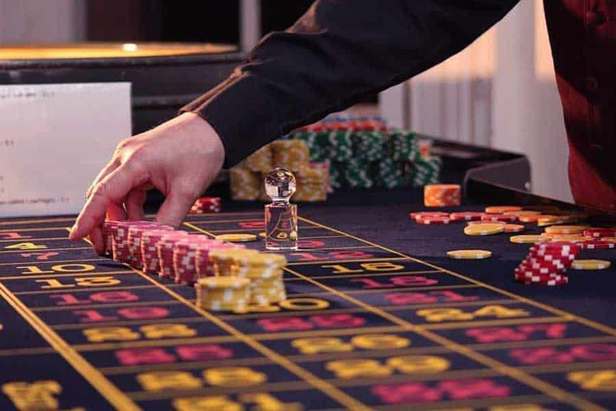 casino chips on a baccarat table
