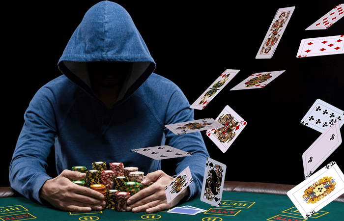 a mysterious man holding poker chips