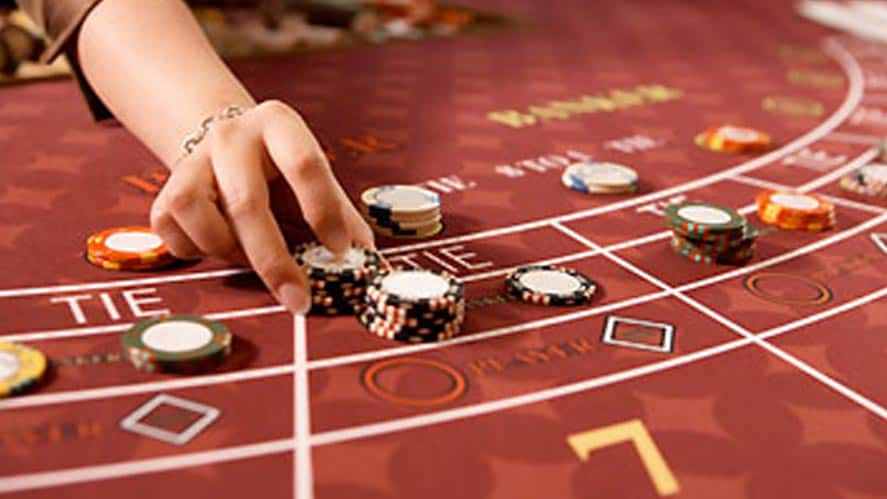 baccarat table with casino chips on it