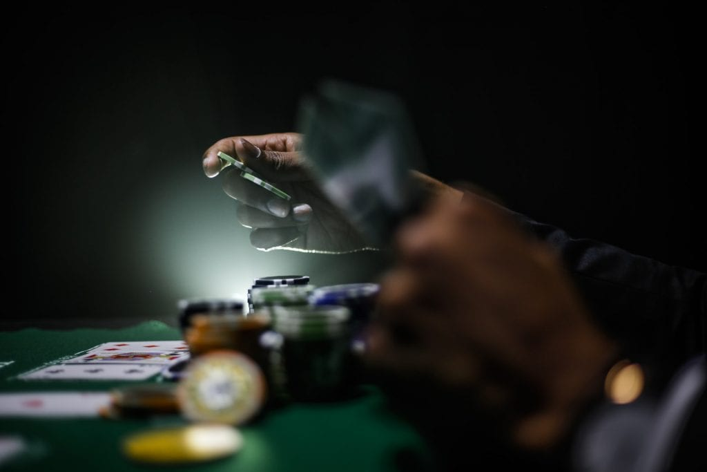 poker dealer dealing with hands