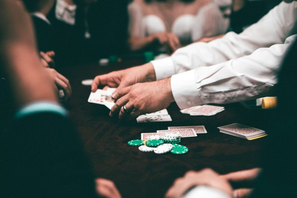 poker dealer dealing cards