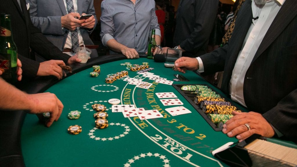 blackjack table with group of people around it
